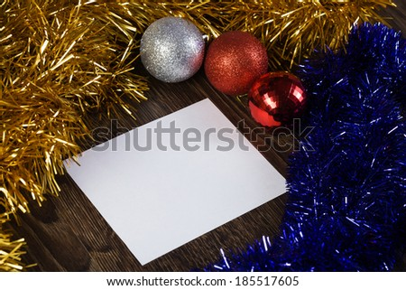 White blank card with decoration balls and tinsel. Place for text - stock photo