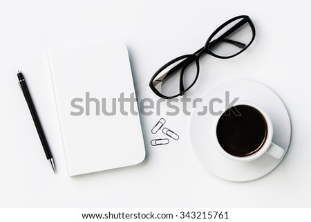 White blank diary cover, cup of coffee and glasses on white table, mock up 3D Render - stock photo