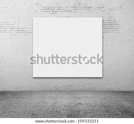 white blank frame on a brick wall - stock photo