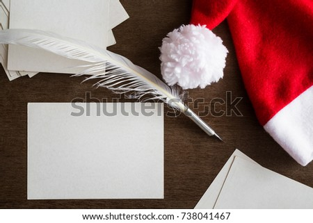 White blank greeting cards old quill stock photo royalty free white blank greeting cards old quill pen and red hat letters to santa claus spiritdancerdesigns Gallery