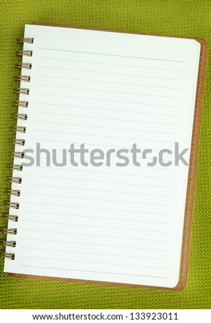 White Blank notebook on green background - stock photo