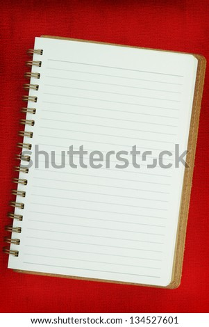 White Blank notebook on red background - stock photo