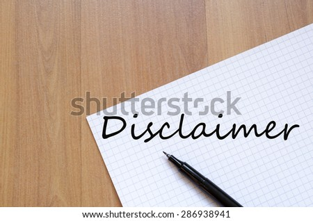 White blank notepad on office wooden table Disclaimer concept - stock photo