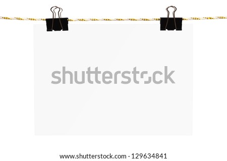 white blank paper hanging on a rope
