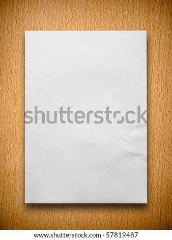 white blank paper on beech wood background - stock photo