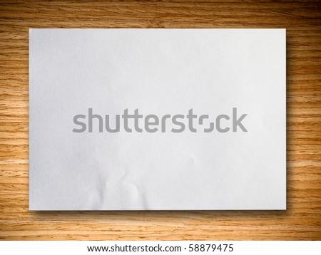 white blank paper on oak wood background horizontal - stock photo