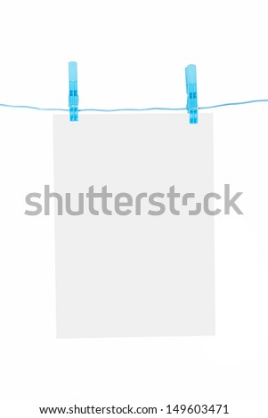 White, blank paper on rope with blue, plastic clothespin, isolated on white background.