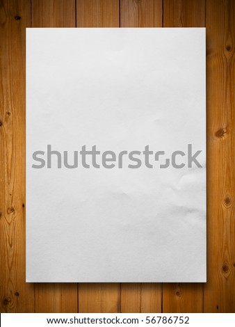 White blank paper on wood background - stock photo