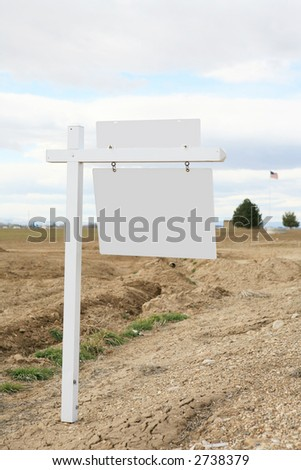 White blank real estate for sale sign in the country - stock photo