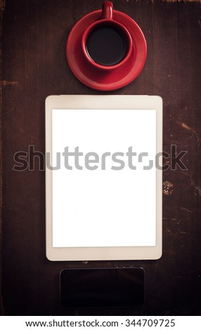 White blank screen on the tablet pc and cup of coffee - stock photo
