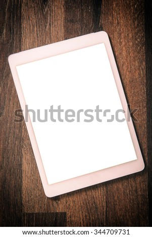 White blank screen on the tablet pc on wooden background  - stock photo
