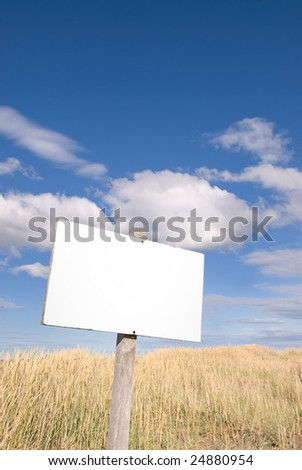 White Blank Sign over Cloudy Sky - stock photo