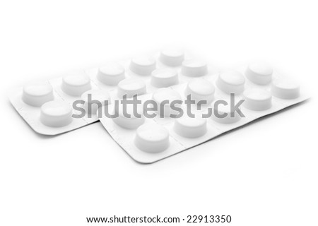 white blister pack of pills against white (shallow DOF) - stock photo