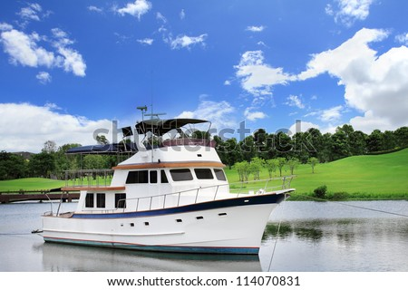 white boat and blue sky - stock photo