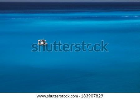 White boat in beautiful sea water - stock photo