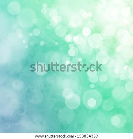 White bokeh on blue green watercolor background - stock photo