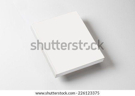 white book on a white table with natural shadow - stock photo