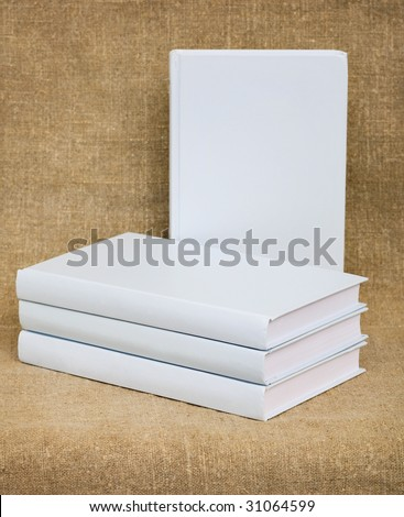 White books on the canvas background - stock photo