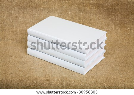White books on the fabric background - stock photo