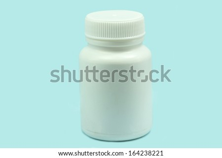 White bottle for drugs on a blue background