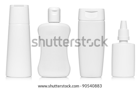 White bottles set isolated on white - stock photo