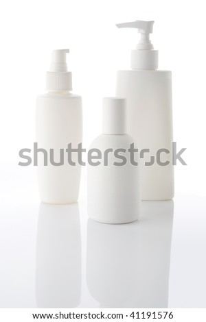 White bottles with cosmetics on a white background - stock photo