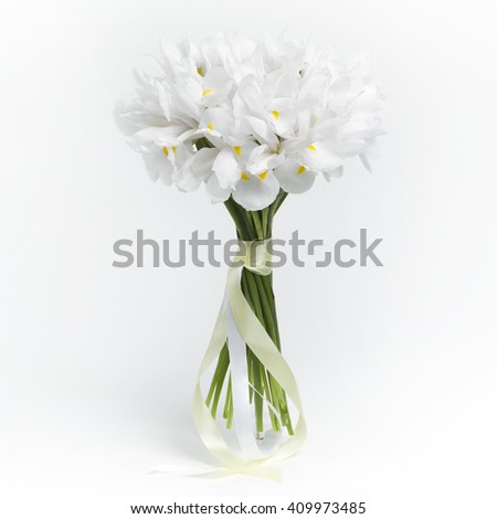 White bouquet of calla flowers on white background - stock photo