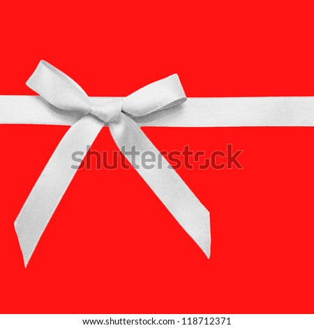 White bow on a red background. Christmas present. Ready for your texts or symbol. - stock photo