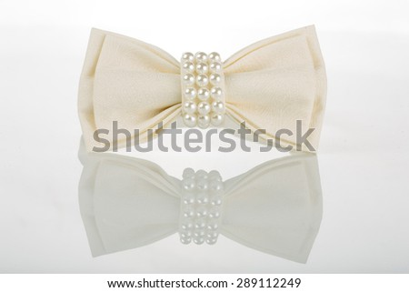 white bow tie with pearls - stock photo