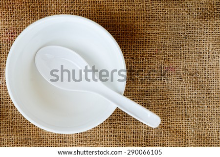 White bowl and spoon on - stock photo