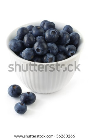 White bowl of blueberries, isolated on white.