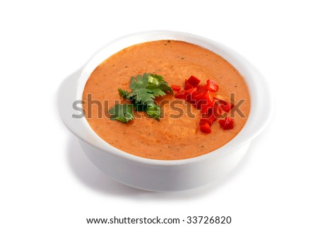 White bowl of gazpacho soup on white background - stock photo