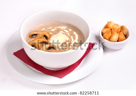 White Bowl of mushroom cream soup with with oven roasted bread isolated on white - stock photo
