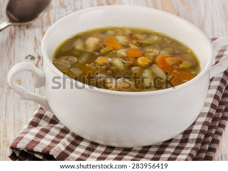 White Bowl of Soup with Lentils, Beans, Chicken and Vegetables. Selective focus - stock photo