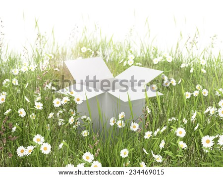 white box on the grass field - stock photo