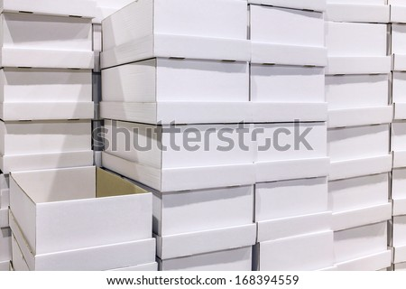 White box package at warehouse. One empty box in the open position - stock photo