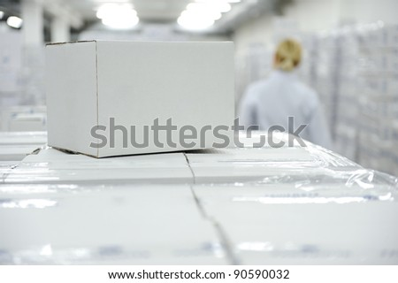 White box package at warehouse ready for your message or logo - stock photo