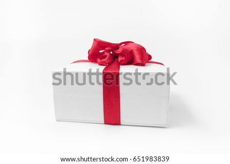 White box with a red bow gift.