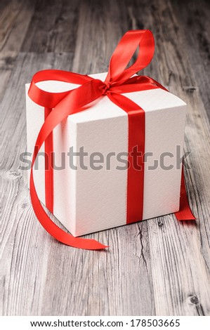 White box with a red ribbon for christmas - stock photo