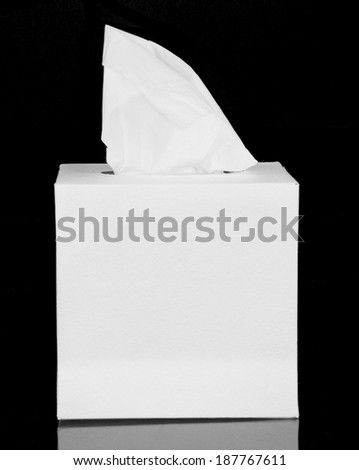 White box with tissue paper isolated on a black background - stock photo