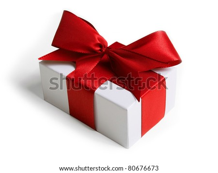 White box wrapped in a red ribbon and bow (with shadow) on white background. - stock photo