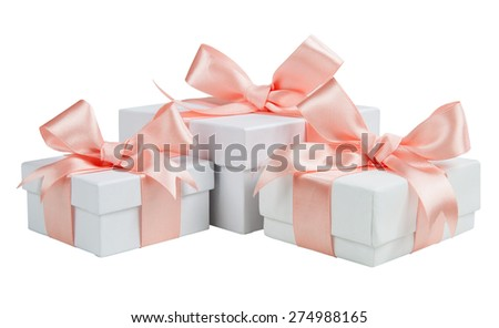 White boxes with pink ribbons isolated on white background - stock photo