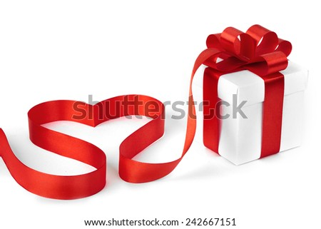 White boxes with red ribbons and decorative heart isolated on white background