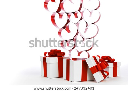 White boxes with red ribbons and decorative hearts isolated on white background - stock photo