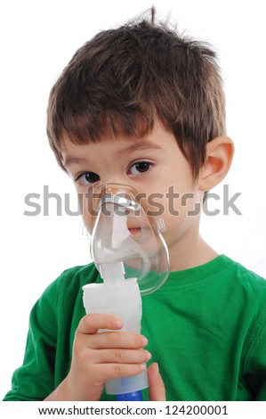 White boy  is having  inhalation at home. - stock photo