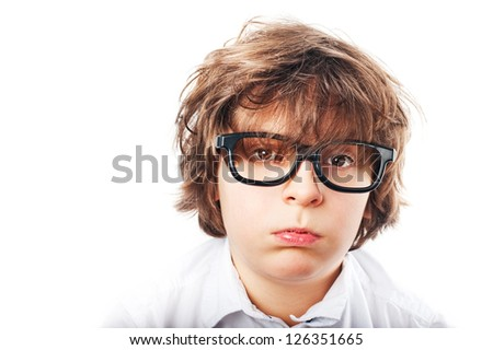 white boy with shaggy hair, a white shirt and fashion glasses, tired looking at the camera - stock photo