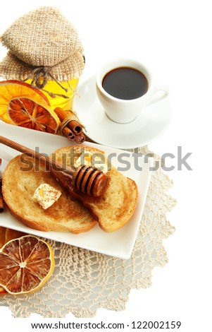 White bread toast with honey and cup of coffee, isolated on white