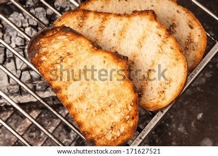 White bread toasted on an outdoor grill - stock photo