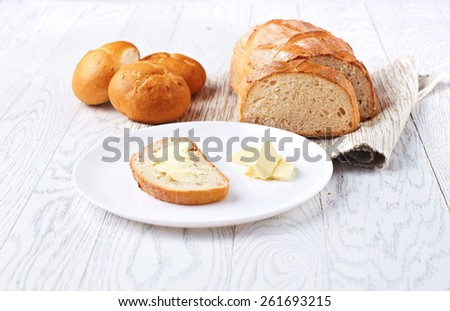 White bread with butter on the wooden table, selective focus - stock photo