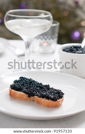 White bread with caviar on a ceramic plate - stock photo